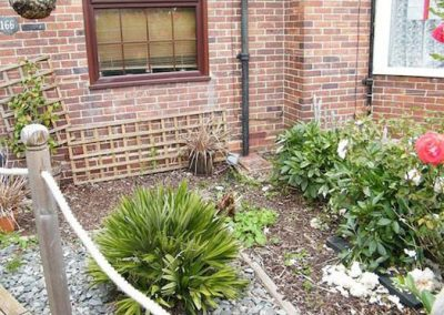 The dull front garden was dry and sparsely planted.