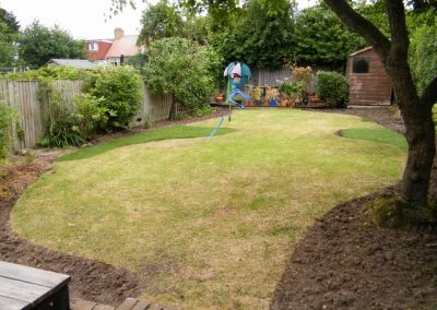 During lawn reshape, gaps are filled and some areas cut out.