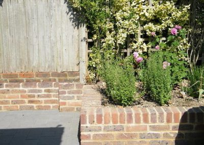 The herb border was created near the house to allow for easy picking of the herbs from the kitchen.