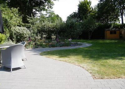 The patio and path create a seamless area for the children to play on.